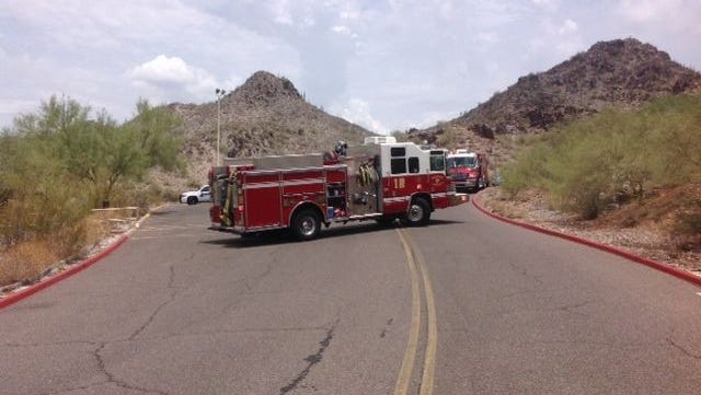 Fire crews work to recovery a body on Piestewa Peak in Phoenix on July 15, 2014.