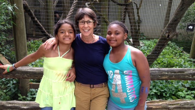 Mariann Caprino of Pine Plains, center, visits the Trevor Zoo at the Millbrook School on Sunday with Evalise Zamot, left, and Ameiya Houston.