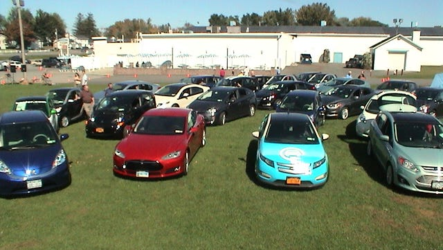 Electric car enthusiasts will gather for a show in Highland on Saturday. Here, electric cars are on display at an earlier electric car show.