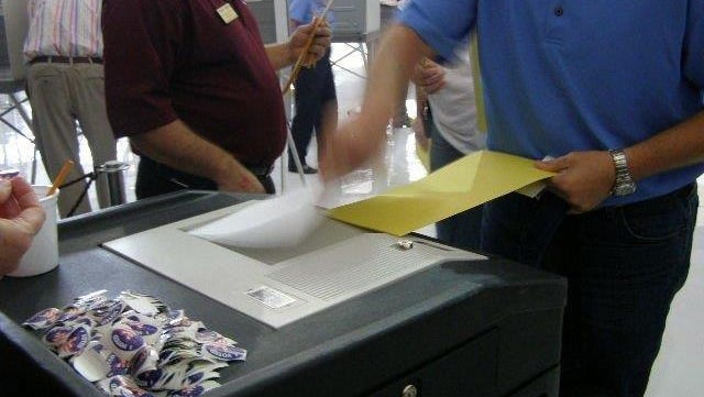 Polk County, Fla., voters cast ballots in a recent mock election using the county's optical-scan voting machines. The test election was conducted for a Chamber of Commerce group.
