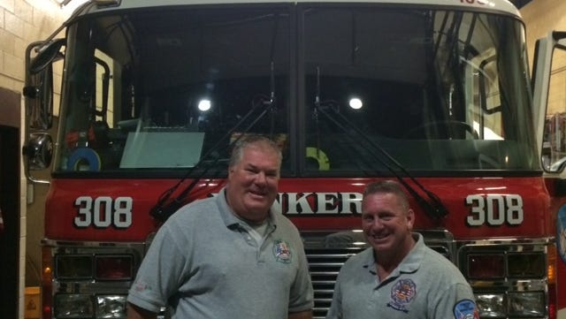 Yonkers fire Lt. Thomas Hewitt, left, and Lt. Michael Hanney saved an 83-year-old man who collapsed at Ardsley's homecoming on Saturday afternoon.
