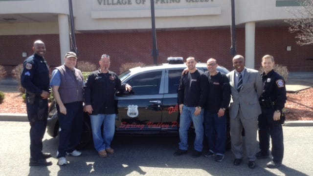 From left, Spring Valley Police Sgt. Rony Charles, auto dealer Sandy Fried, businessmen Anthony Pellitteri, Sam Pena Jr. and Sam Pena, and Spring Valley Mayor Demeza Delhomme, and Spring Valley DARE Officer Francis Brooke.