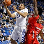 Kentucky's Isaiah Briscoe, left, shoots while defended by Illinois State's Paris Lee during the second half of an NCAA college basketball game Monday, Nov. 30, 2015, in Lexington, Ky. Kentucky won 75-63. (AP Photo/James Crisp)