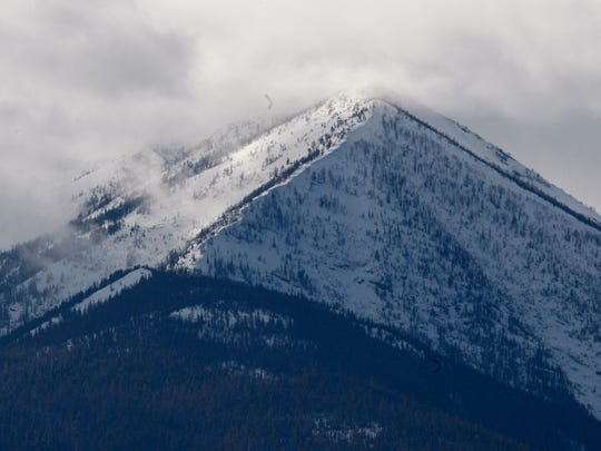 The snowcapped Cabinet Mountains tower over the lush Kootenai River Valley outside of Libby.