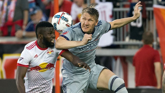 Fire midfielder Bastian Schweinsteiger (31) fights for a high ball against New York Red Bulls defender Kemar Lawrence (92) during the first half at Red Bull Arena. Lawrence scored the winning goal.