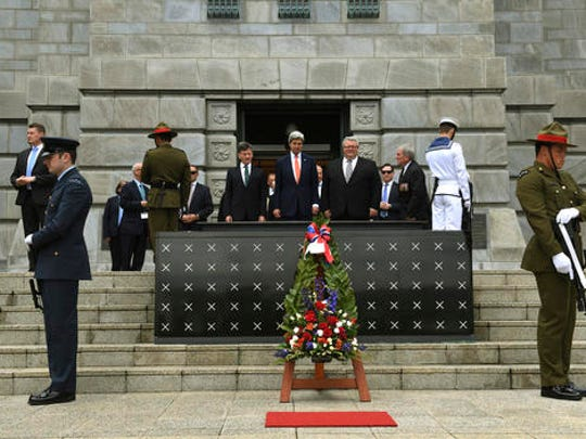 U.S. Secretary of State John Kerry, center,  attends a wreath laying and medals ceremony at the National War Memorial in Wellington, New Zealand Sunday,  Nov. 13, 2016.