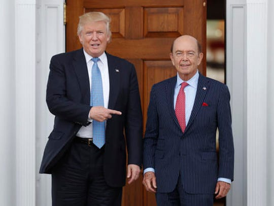 FILE - In this Sunday, Nov. 20, 2016, file photo, President-elect Donald Trump, left, stands with investor Wilbur Ross after meeting at the Trump National Golf Club Bedminster clubhouse in Bedminster, N.J. Trump is poised to offer the position of commerce secretary to the head of a private-equity firm, Wilbur Ross.