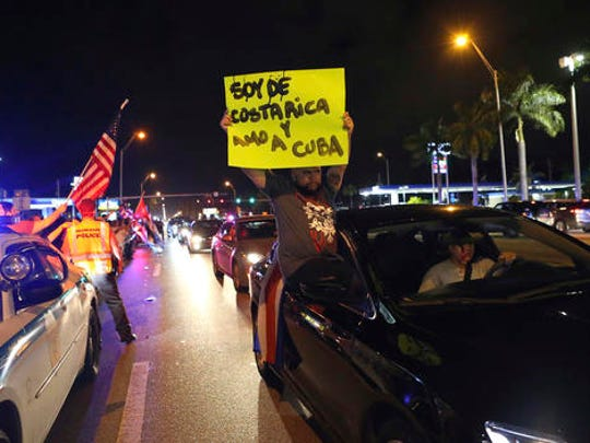 The Cuban community and others in Miami celebrate the announcement that Fidel Castro died as they drive past and gather in the street in front La Carreta Restaurant early Saturday, Nov. 26, 2016, in Miami. Within half an hour of the Cuban government's official announcement that former President Fidel Castro had died, Friday, Nov. 25, 2016, at age 90, Miami's Little Havana teemed with life - and cheers.
