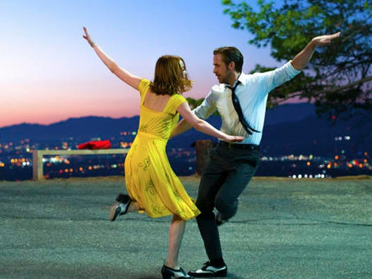 "This image released by Lionsgate shows Ryan Gosling, right, and Emma Stone in a scene from, ""La La Land."""