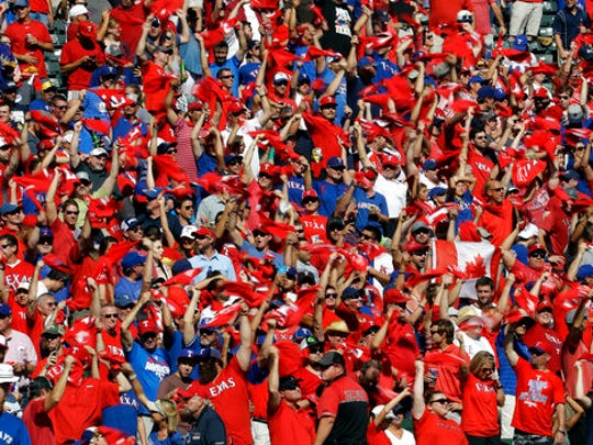 FILE - In this Oct. 6, 2016, file photo, fans waves towels after the playing of the national anthem during Game 1 of the American League Division Series between the Toronto Blue Jays and the Texas Rangers, in Arlington, Texas.  Now that the Cubs have broken baseball's oldest curse, who's next? No team from Texas has ever won the World Series.