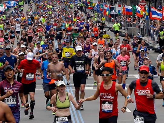 Runners head to the finish line in the 121st Boston Marathon on Monday, April 17, 2017, in Boston.