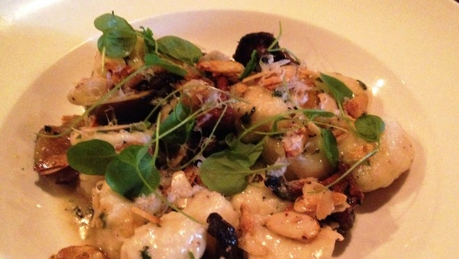 Ricotta gnudi at Domaine Hudson has braised chanterelle mushrooms, figs, almond, and red chili crumble with tarragon.