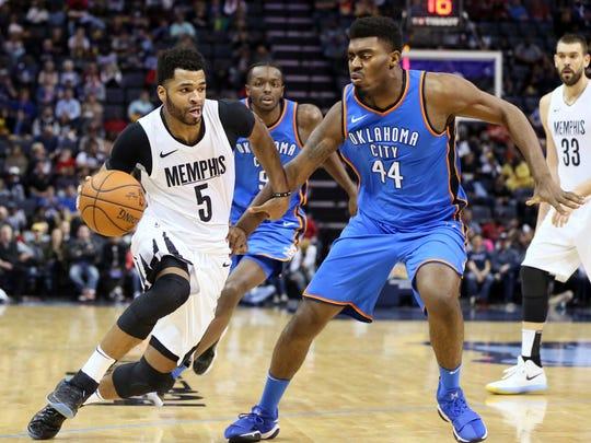 Memphis Grizzlies guard Andrew Harrison (5) drives against Oklahoma City Thunder center Dakari Johnson (44) at FedExForum. Thunder won 121-114.