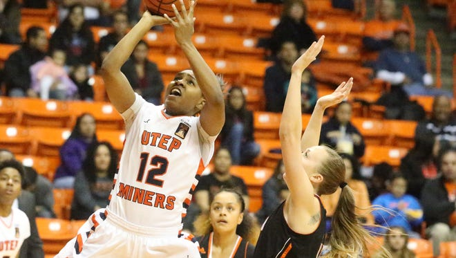 Sparkle Taylor, 12, of UTEP goes up for a shot against UT-Permian Basin earlier this season. Taylor has been a spark for UTEP..