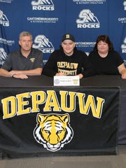 Salem distance swimmer Phillip Collingwood (seated, center) makes it official on National Signing Day. He'll swim at Depauw University. Also photographed are parents Ian and Gill.