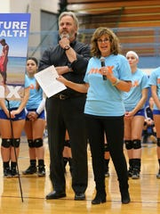 Before a recent Salem volleyball game, John and Lisa