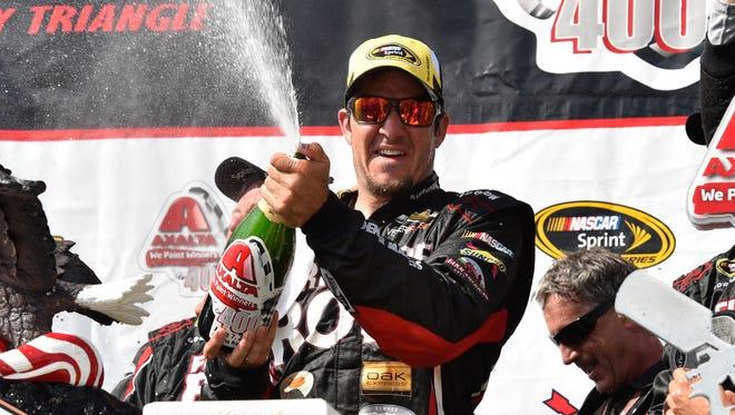 Martin Truex Jr. celebrates in Victory Lane at Pocono Raceway after winning a NASCAR Sprint Cup Series auto race at Pocono Raceway in Long Pond, Pa., Sunday, June 7, 2015.