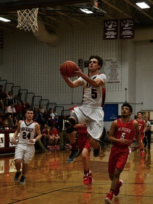 Avery County's Jeffrey Puckett (5) never lost a conference game in his varsity basketball career.