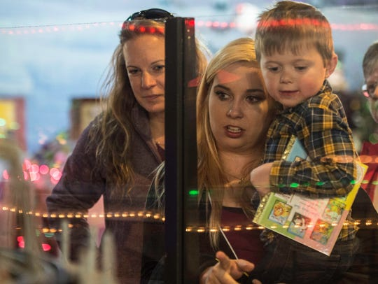 Families look at model trains at the 13th annual Old