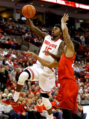 Dec 22, 2014; Columbus, OH, USA; Ohio State Buckeyes guard Kam Williams (15) shoots over Miami (Oh) Redhawks guard Tre Hawkins (20) during the first half at Value City Arena. Mandatory Credit: Joe Maiorana-USA TODAY Sports