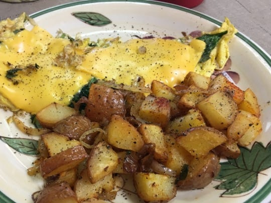 Ellie's Breakfast and Sub Shop's Florentine omelet was whipped to perfection and the spinach was fresh. It was were served with a side of home fries.