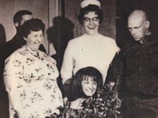 In this vintage photograph, possibly taken at Fulton County Medical Center on or around May 18, 1966, kidnap victim Peggy Ann Bradnick is reunited with her family after a seven-day ordeal that sparked the largest manhunt in U.S. history at the time. Bradnick spoke to the Fulton County Historical Society in 2016 on the 50th anniversary of her abduction.