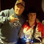Andy Bushey, 16, of Shiloh, tries on the hat given to him by his hero Garth Brooks after a concert last week.