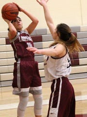 Tularosa's Ember Cervantes, left, puts up a shot while being defended by Taylor Noblitt.