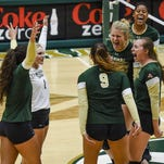 CSU volleyball celebrates winning the second set against UC-Davis Saturday at Moby Arena.