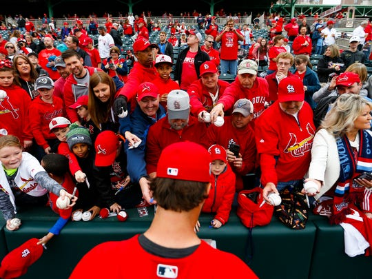 St. Louis Cardinals pitcher Adam Wainwright signs autographs before the start of the St. Louis Cardinals vs Springfield Cardinals game in Friday, March 31, 2017.