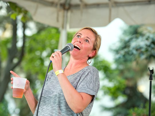 Sally Brooks of Morgantown, W. Va., entertains the crowd at one of the beer booth stages in 2014.