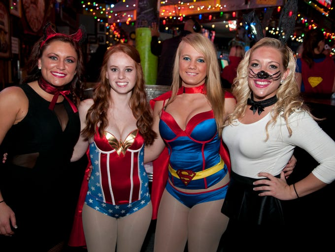 People dress in costume for a Halloween party at Tin Roof, Thursday, Oct. 31, 2013.