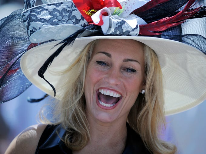 Race fans show many different hats at the 140th Kentucky Derby on Saturday at Churchill Downs. May 3, 2014