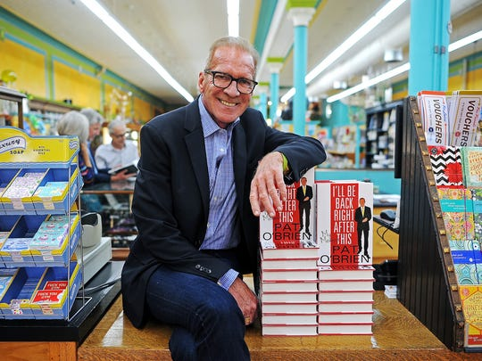 "Pat O'Brien, author, radio and TV host and sportscaster, poses for a portrait with copies of his book, ""I'll Be Back Right After This,"" on Thursday, Sept. 18, 2014, at Zandbroz Variety in Sioux Falls, S.D."