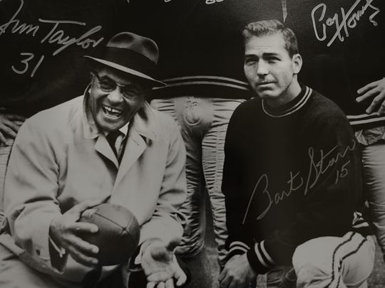 A photo inside Bart Starr's office in Birmingham, Ala., shows the young quarterback with Green Bay Packers coach Vince Lombardi.