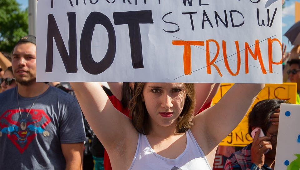 17-year-old Sofia Hoskins holds up a sign outside the