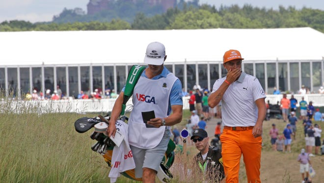 With Holy Hill in the background, Rickie Fowler walks from the third to the fourth hole Sunday during the final round of the U.S. Open at Erin Hills.