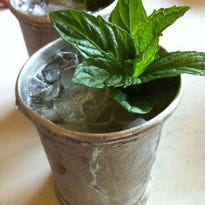 Muddle bourbon, watermelon and mint to make Watermelon Mint Juleps.