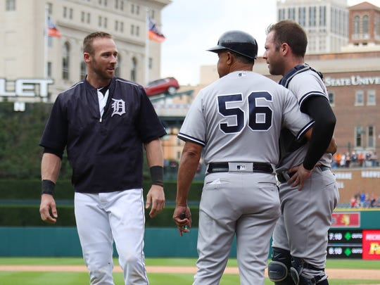 Andrew Romine, left, of the Detroit Tigers talks to his brother Austin Romine, right, of the New York Yankees and first base coach first base coach Tony Pena during a bench clearing fight in the seventh inning at Comerica Park on August 24, 2017 in Detroit.