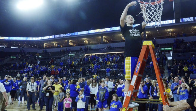 SDSU's Chynna Stevens cuts down part of the net after their 72-57 win over USD in the 2015 Summit League women's basketball championship at the Denny Sanford Premier Center.