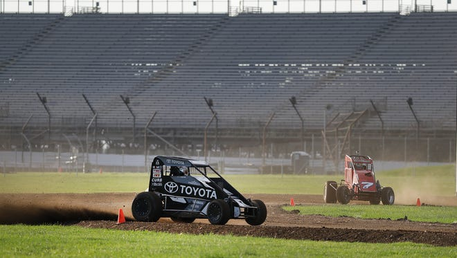 Midget cars drivers take their turn on the 3/16th oval dirt track Tuesday, Jul 5, 2016, evening at the Indianapolis Motor Speedway.