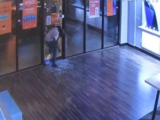 MPD is looking for two men who broke into two Boost Mobile stores.
