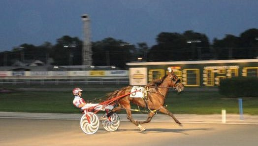 Dime A Dance nears the wire at Batavia Downs on Wednesday night, Sept. 16, 2015, after pulling ahead of the field.