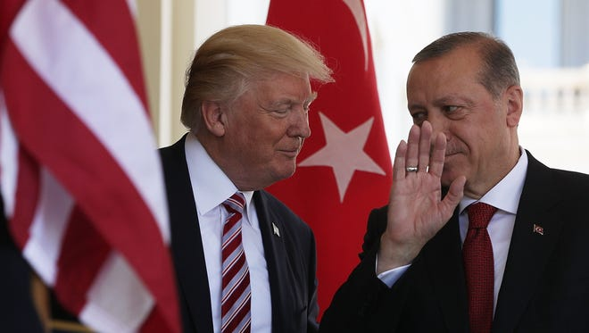 President Trump welcomes Turkish President Recep Tayyip Erdogan outside the West Wing of the White House Tuesday.