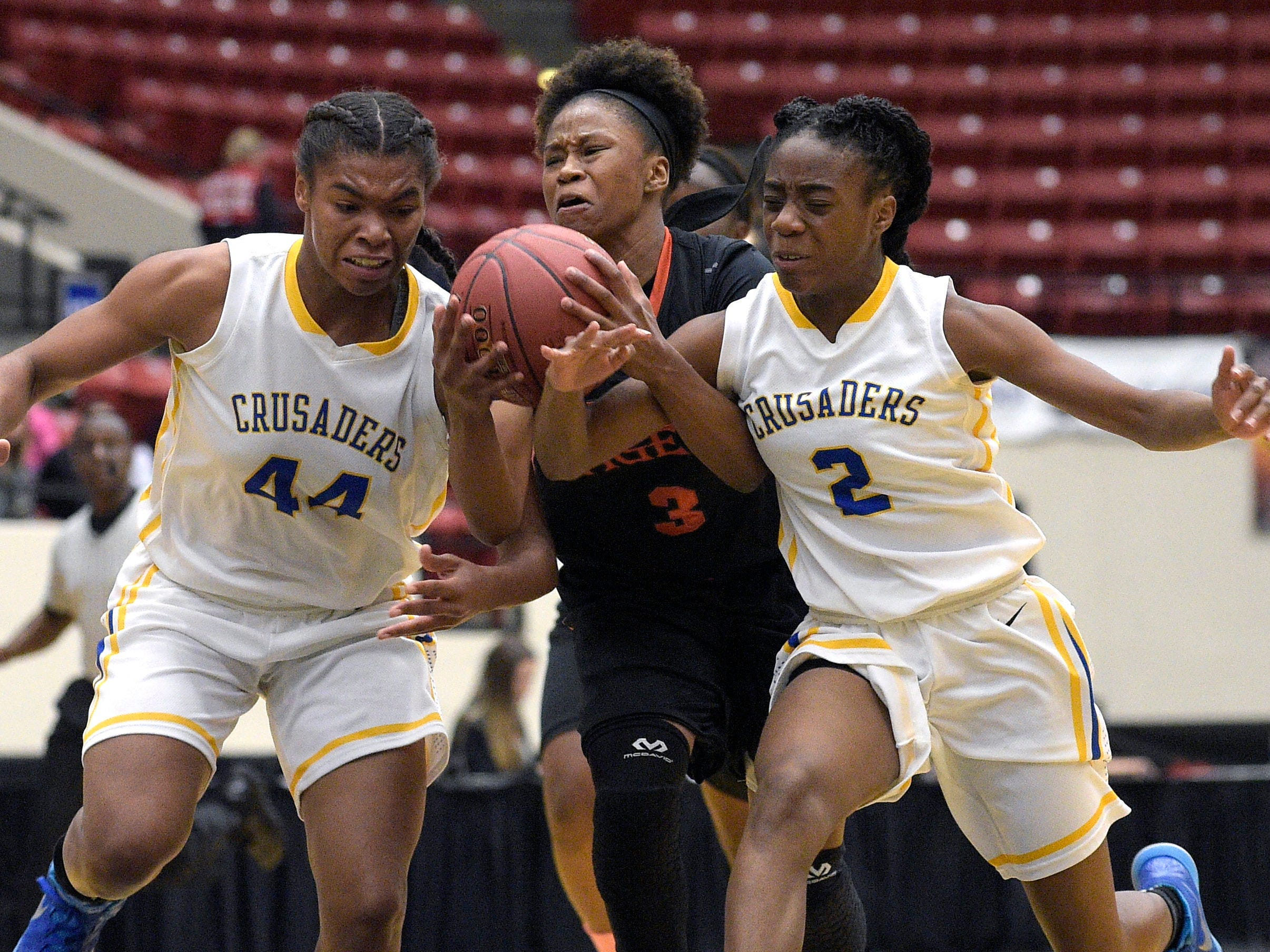 Dunbar's Keri Jewett (3) is fouled by Cardinal Newman's Anise Williams (2), while driving to the basket between Williams and Tytionia Adderly (44) during a girls basketball game at the FHSAA State Finals, Tuesday, Feb. 17, 2015, in Lakeland, Fla.(Photo/Phelan M. Ebenhack)