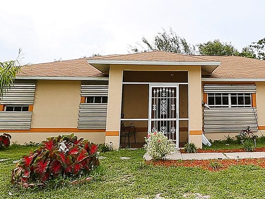 Lula Florence's house is covered with hurricane shutters. Florence's uses the shutters to protect her family from shootings in the Dunbar community of Fort Myers.