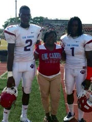 Kershena Thomas with her sons Jawon (2) and Khane Pass during their high school playing days.