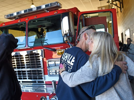 Denise Kirby gives one last kiss and hug to her husband Ryan who is leaving with other members of Engine 4 to fight wildfires around the Gatlinburg area.A number of Middle Tennessee fire and rescue crews are deploying to East Tennessee to help fight the wildfire near Gatlinburg that has forced thousands to evacuate.The Nashville Fire Department announced Tuesday it would send 14 of its personnel and five vehicles to Sevier County to help with the response to the destructive wildfire. Tuesday Nov. 29, 2016, in Nashville, Tenn.