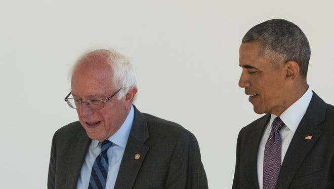 President Barack Obama (D) walks with Sen. Bernie Sanders through the Colonnade for a meeting in the Oval Office on June 9, 2016 at the White House in Washington, DC.