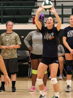 UTEP volleyball players demonstrate a set during a clinic Monday afternoon at Cloudcroft High School.